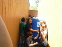 students with their rain barrels
