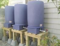Elevated rain barrels
