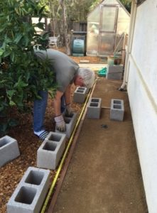 The foundation pad is a simple frame filled with compact gravel - a solid surface for the cinder block footing and barrels.