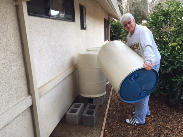 man lift rain barrel