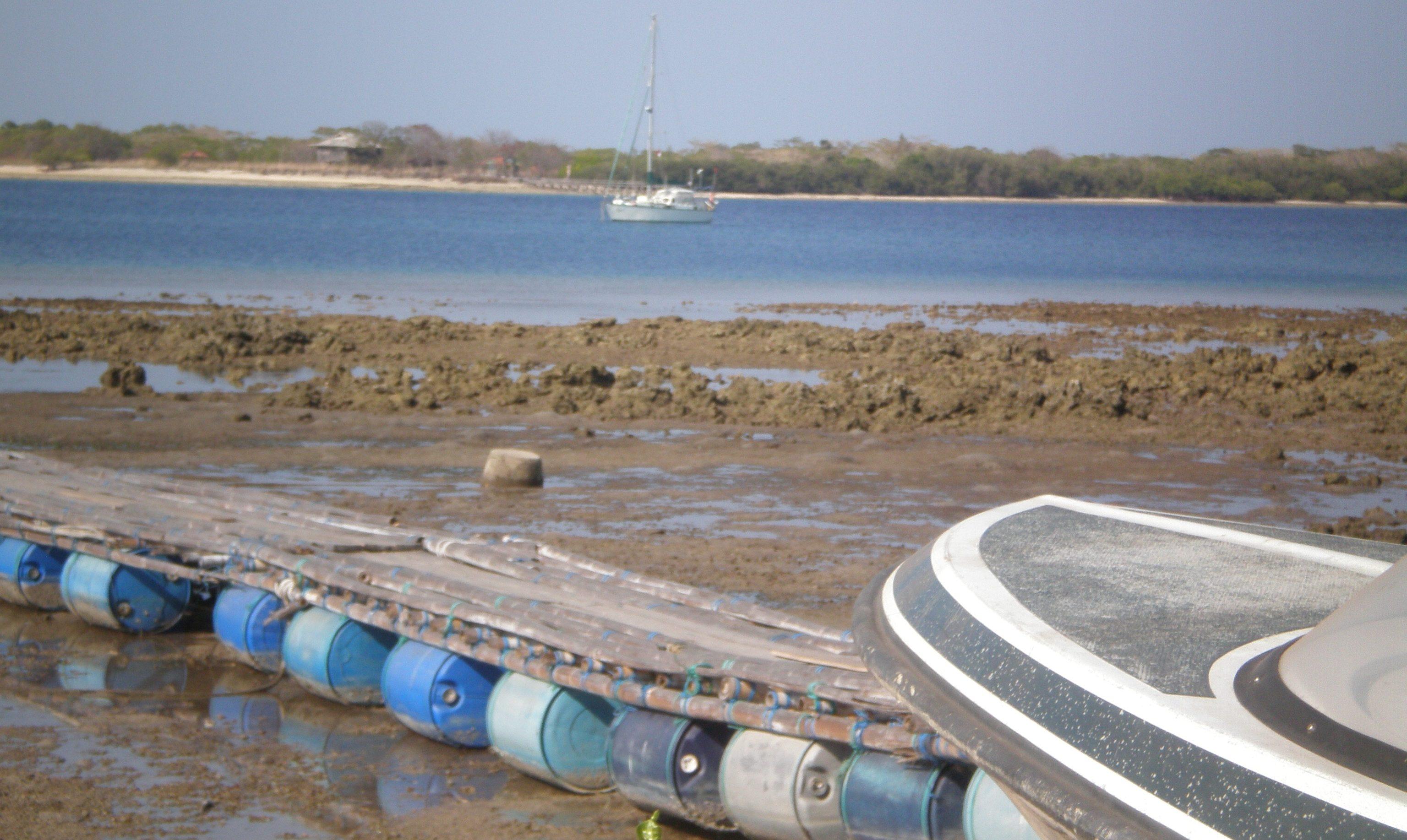 blue barrels floating dock in indonesia