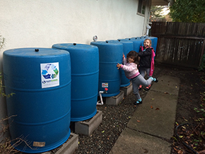 """""""Just wanted to share the exciting news that our barrels filled up for the first time yesterday! Thanks for all your help, BlueBarrel. Rain is so much more exciting now. I've run outside in the rain several times this year to check the tank gauge and watch the system while it's working. Happy days!"""" - Steve, Davis CA"""