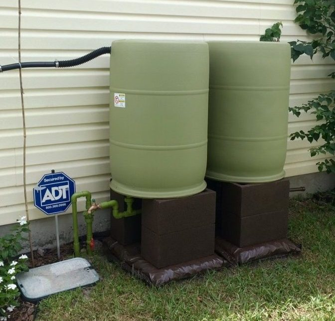 green painted rain barrels