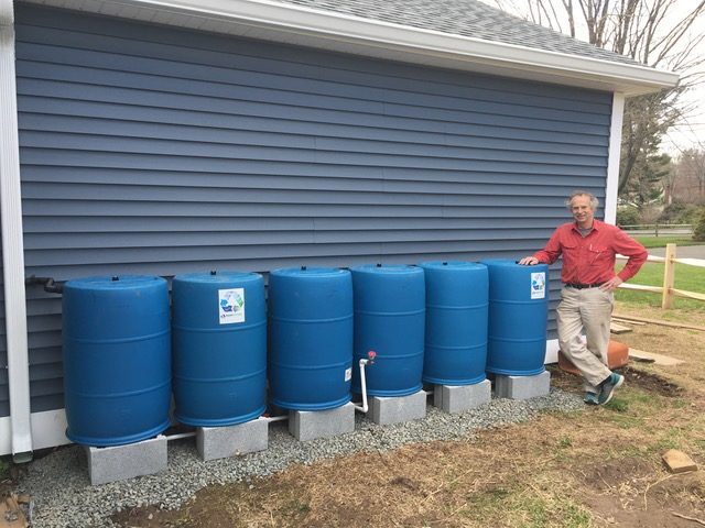 Terry with his 6-Barrel BlueBarrel Rainwater Catchment System