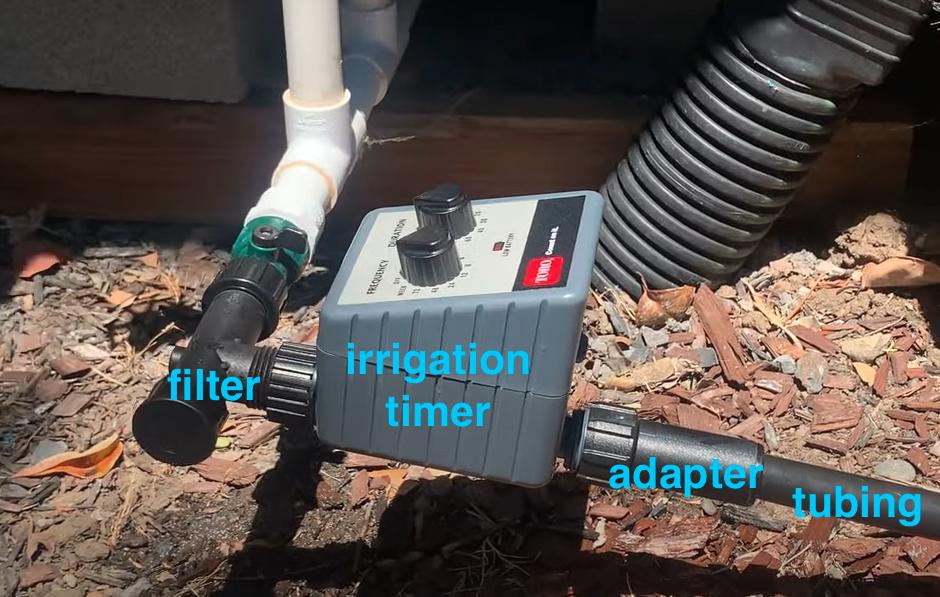 set up drip irrigation filter, timer, tubing