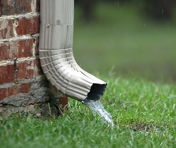 system overflow downspout drop off into grass