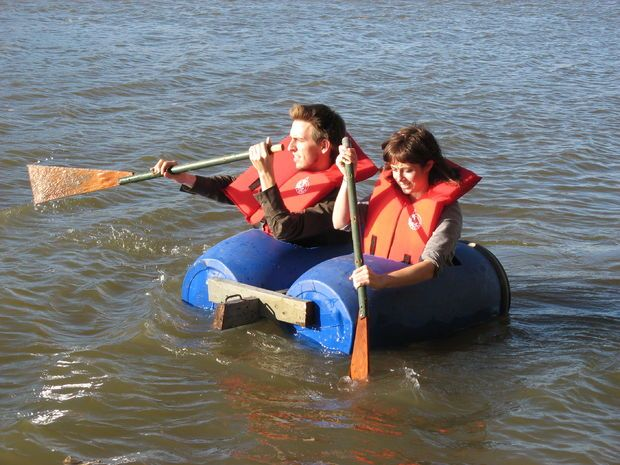 A blue barrel boat built for two. Click the image to visit the DIY blog.